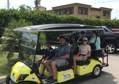 Family of 6 on yellow golf cart rental in Marco Island