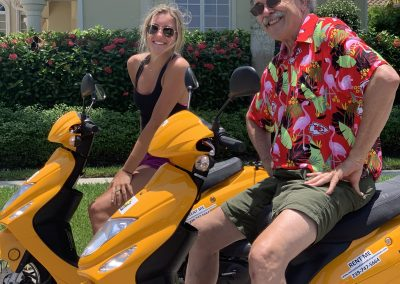 Grandpa and granddaughter on scooter rentals in Marco Island