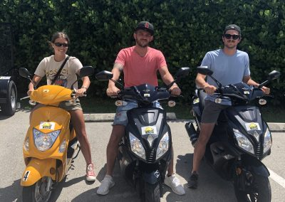 Group of 3 riding 3 scooter rentals on Marco Island