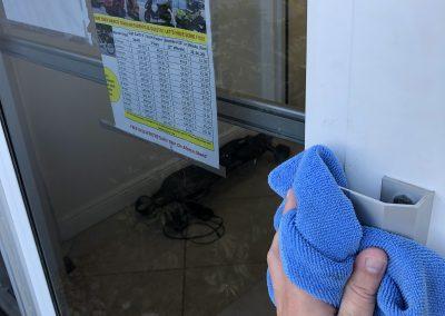 Sun-N-Fun staff member cleaning a door handle