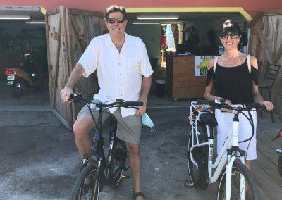 Couple riding electric bike rentals from Sun-N-Fun Sport Rentals