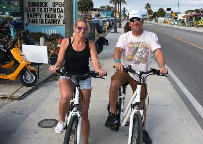 Man and woman on white electric bike rentals