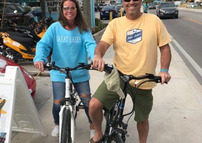 Couple riding e-bike rentals